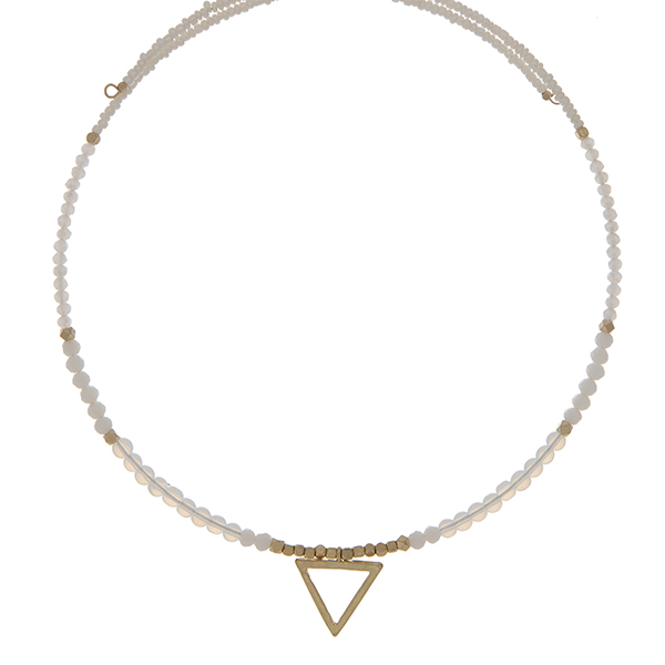 White and opal beaded memory wire choker with gold tone accents and a triangle pendant. Choker does not close, so it can fit up to almost any size.
