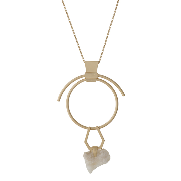 "Gold tone necklace with a geometric pendant, accented with an ivory druzy stone. Approximately 27"" in length."