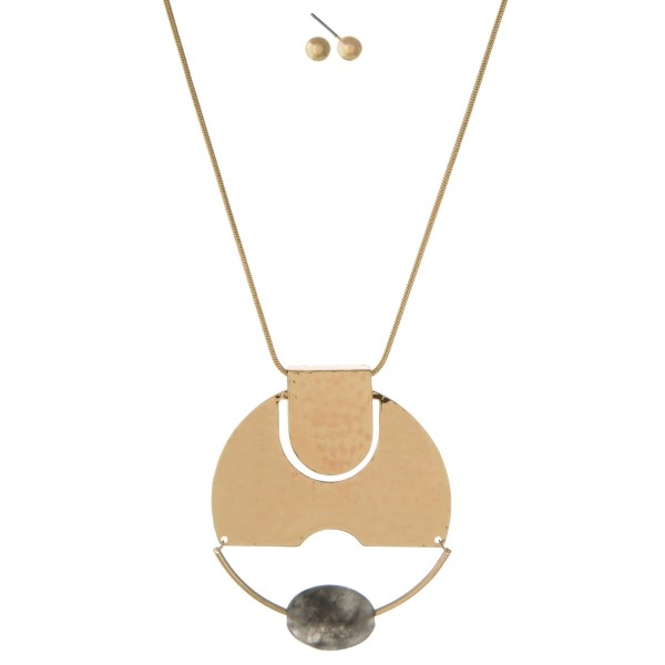 "Gold tone necklace set with a hammered circle pendant and gray faceted bead. Approximately 32"" in length."