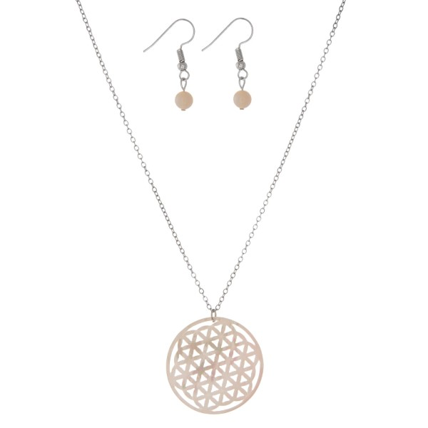 """Silver tone necklace set with a white, laser cut, circle pendant and matching fishhook earrings. Approximately 16"""" in length."""