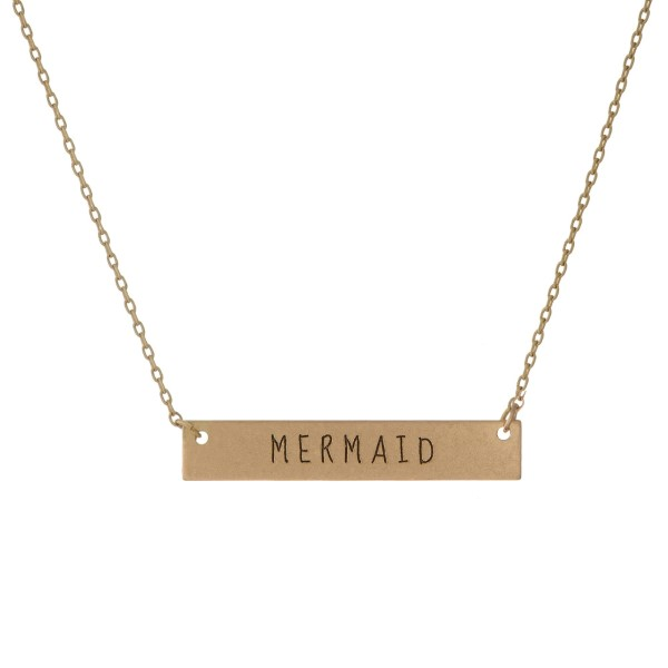 "Matte gold tone bar necklace stamped with ""Mermaid."" Approximately 14"" in length."