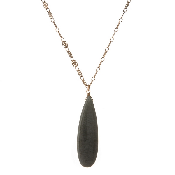 """Gold tone flower chain necklace featuring a gray, teardrop natural stone pendant. Approximately 32"""" in length."""