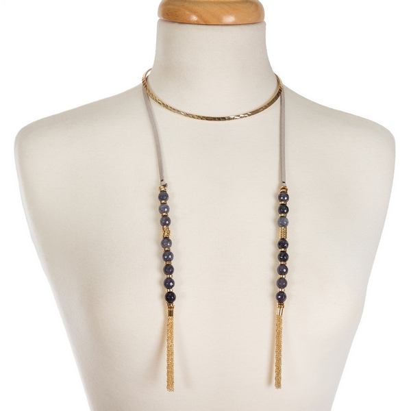 "Gold tone open metal choker featuring gray faux suede pieces with gray natural stone beads and chain tassels. Approximately 16"" in length."