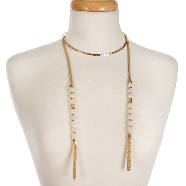 """Gold tone open metal choker featuring tan faux suede pieces with white natural stone beads and chain tassels. Approximately 16"""" in length."""