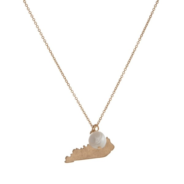 "Dainty gold tone necklace with a state of Kentucky pendant and a freshwater pearl accent. Approximately 16"" in length."