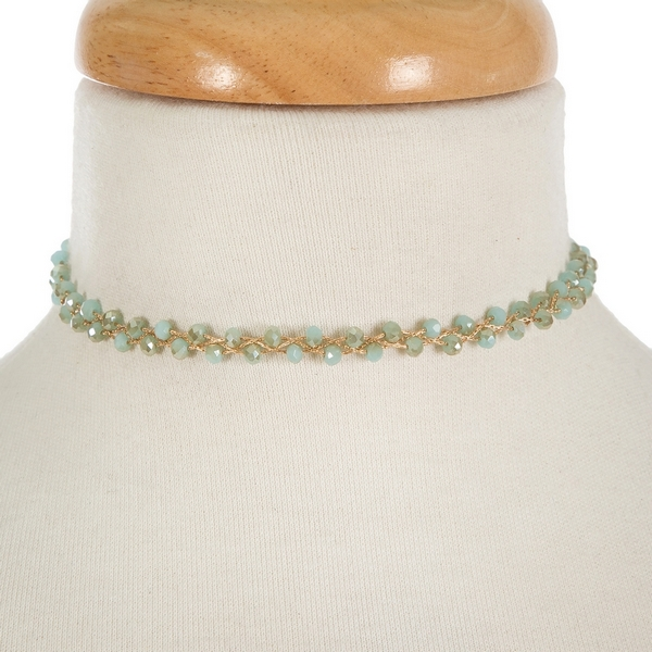 "Gold tone, wire wrapped, mint green beaded choker with matching stud earrings. Approximately 12"" in length."