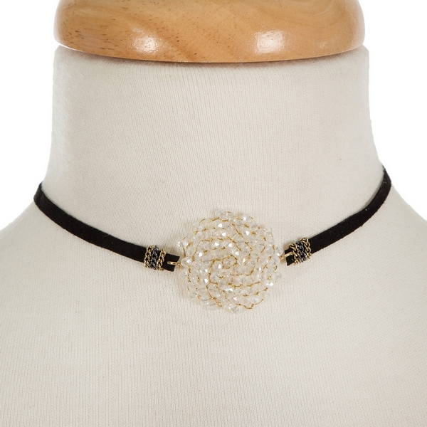 "Black suede choker featuring a gold tone, wire wrapped opal focal. Approximately 114"" in length."