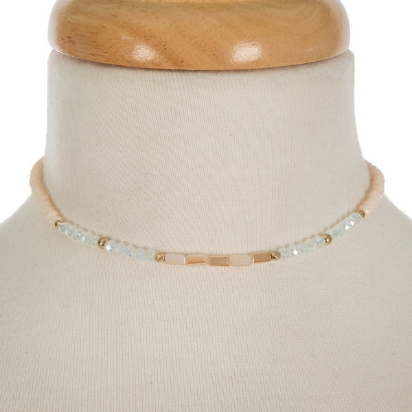 "Ivory, champagne and opal beaded choker with gold tone accents. Approximately 12"" in length."