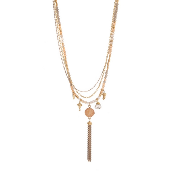 "Gold tone layered necklace featuring gray and topaz beads and a chain tassel. Approximately 26"" to 30"" in length."
