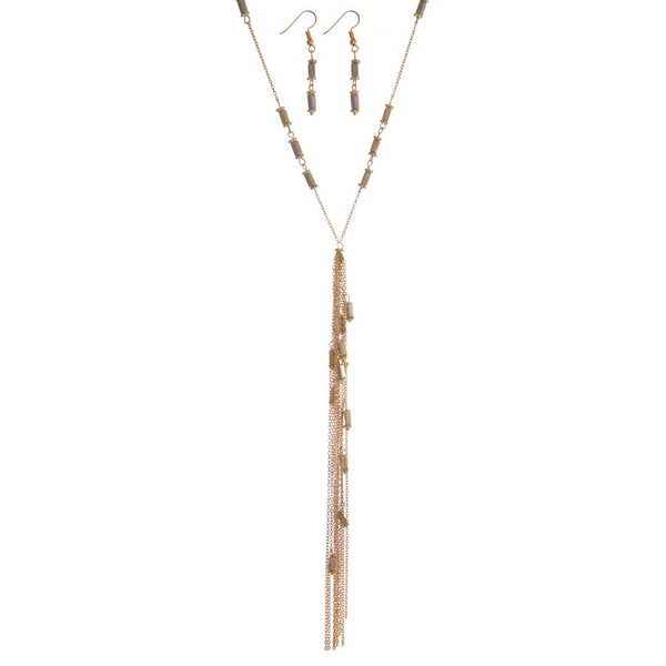 "Gold tone necklace set featuring gray beads, a chain tassel and matching fishhook earrings. Approximately 34"" in length."