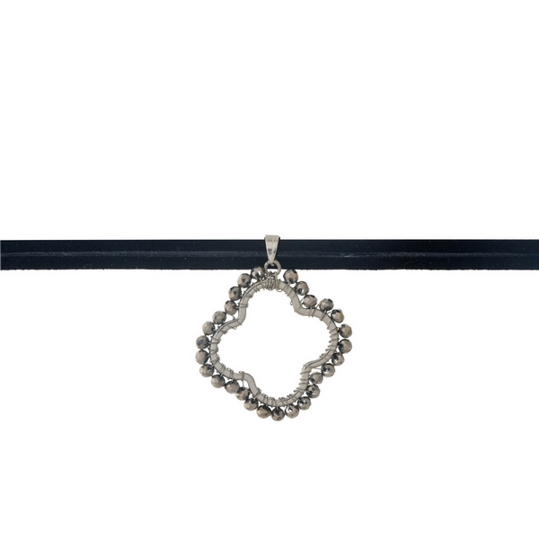 "Black faux suede wrap choker with a gray beaded clover pendant. Approximately 24"" in length."