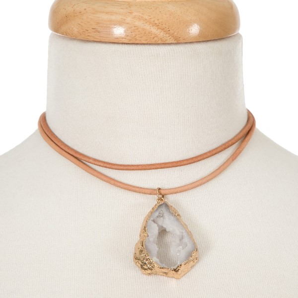 "Brown leather choker with a white druzy natural stone pendant. Approximately 12"" in length."