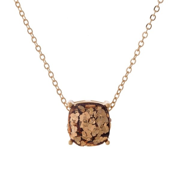 "Gold tone necklace with a topaz glitter, square pendant. Approximately 16"" in length."