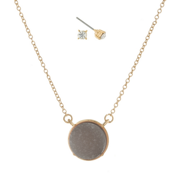 "Gold tone necklace set with a gray faux druzy circle stone pendant and matching stud earrings. Approximately 16"" in length."