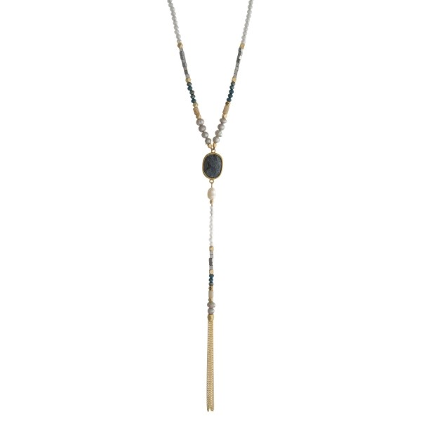 "Gold tone necklace with gray and blue beads and a dainty chain tassel. Approximately 24"" in length."