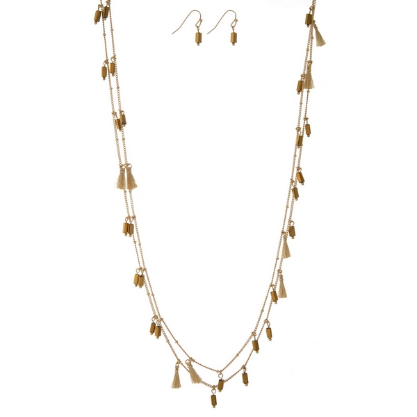 "Gold tone wrap necklace set with bronze tassels and beads and matching fishhook earrings. Approximately 60"" in length."