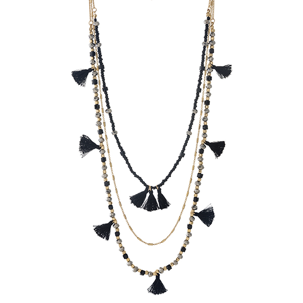 """Gold tone and black beaded three layer necklace with gray accents and thread tassels. Approximately 24"""" to 30"""" in length."""