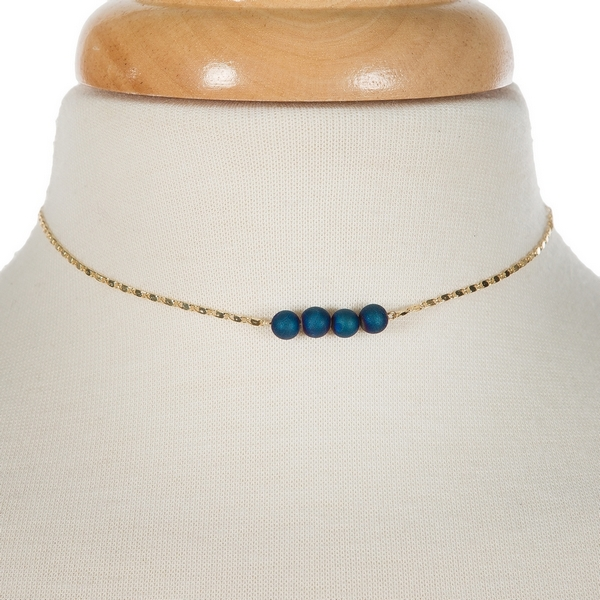"Gold tone necklace with a blue druzy natural stone bar pendant. Approximately 13"" in length."