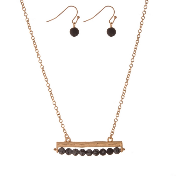 """Gold tone necklace set with a black, natural stone beaded bar pendant and matching fishhook earrings. Approximately 16"""" in length."""