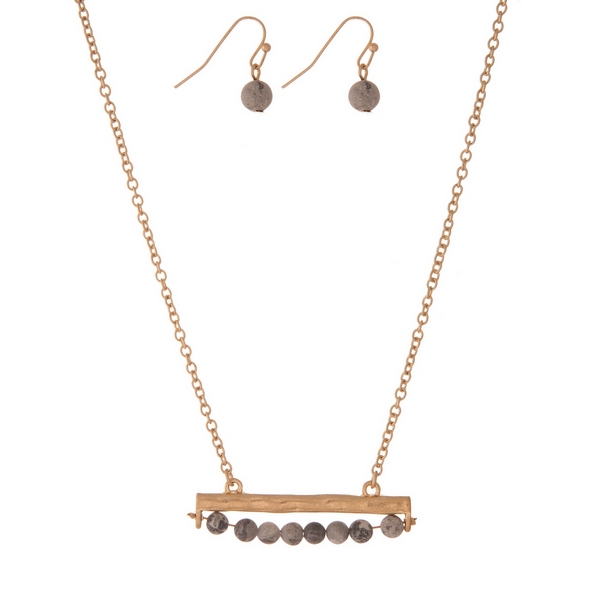 """Gold tone necklace set with a gray jasper, natural stone beaded bar pendant and matching fishhook earrings. Approximately 16"""" in length."""