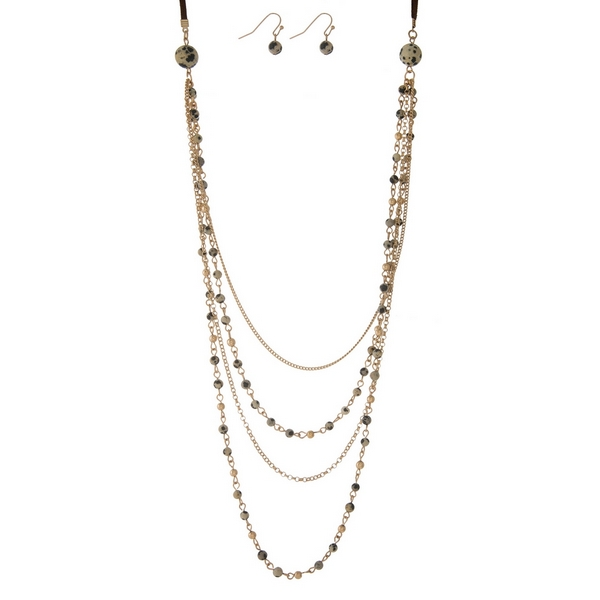 """Faux suede necklace set with layers of dalmatian jasper natural stone beads and matching fishhook earrings. Adjustable up to 30"""" in length."""