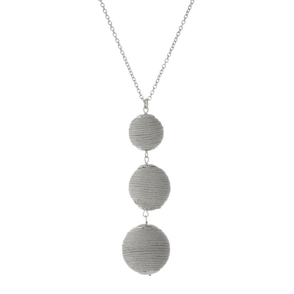 """Silver tone necklace with three, metallic silver thread wrapped beads. Approximately 30"""" in length."""