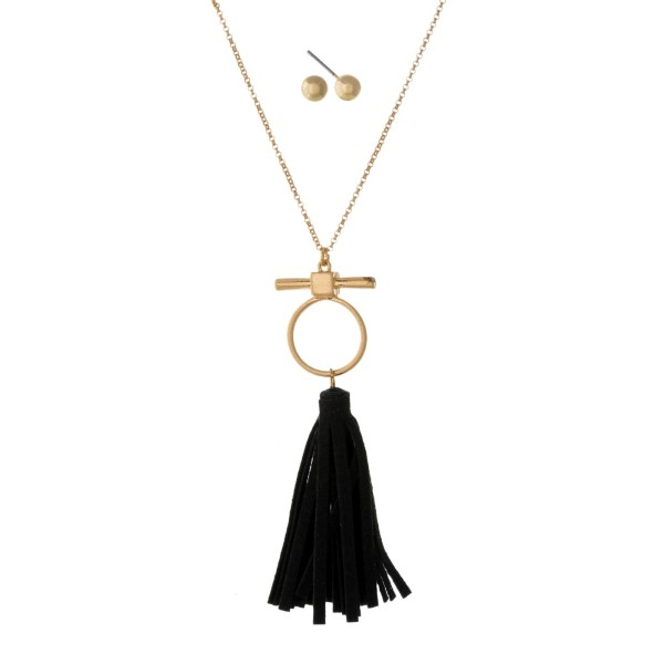 """Dainty gold tone necklace set with a black faux leather tassel pendant and matching stud earrings. Approximately 28"""" in length."""