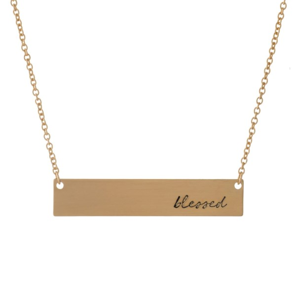 "Dainty gold tone necklace with a bar pendant, stamped with ""blessed."" Approximately 16"" in length."