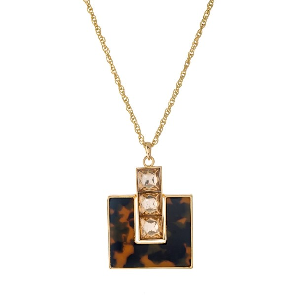 """Gold tone necklace with a square shaped, tortoise shell pendant. Approximately 32"""" in length."""