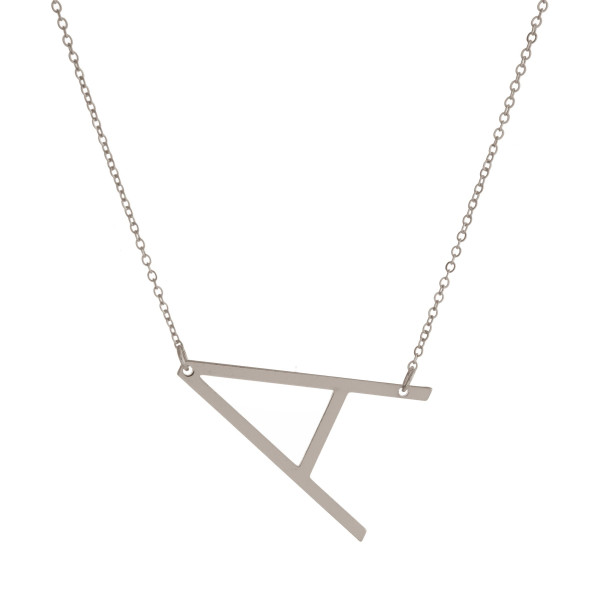 "Dainty silver tone necklace with a 1.5"" sideways, initial pendant. Approximately 16"" in length."