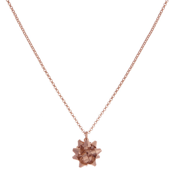 """Dainty necklace set with a bow pendant and matching stud earrings. Approximately 16"""" in length."""