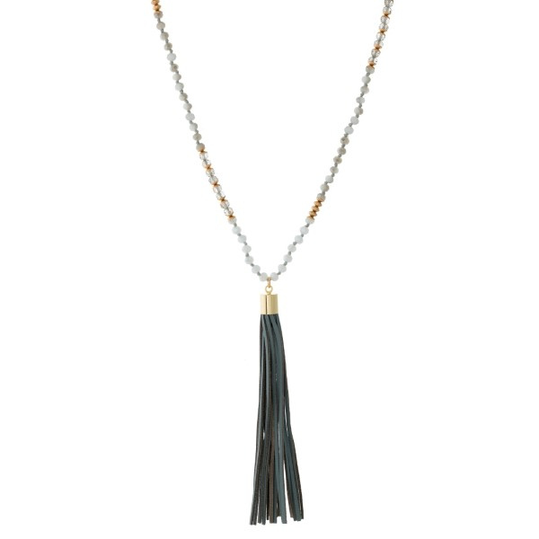 "Full beaded necklace with a faux leather pendant and gold tone accents. Approximately 30"" in length."