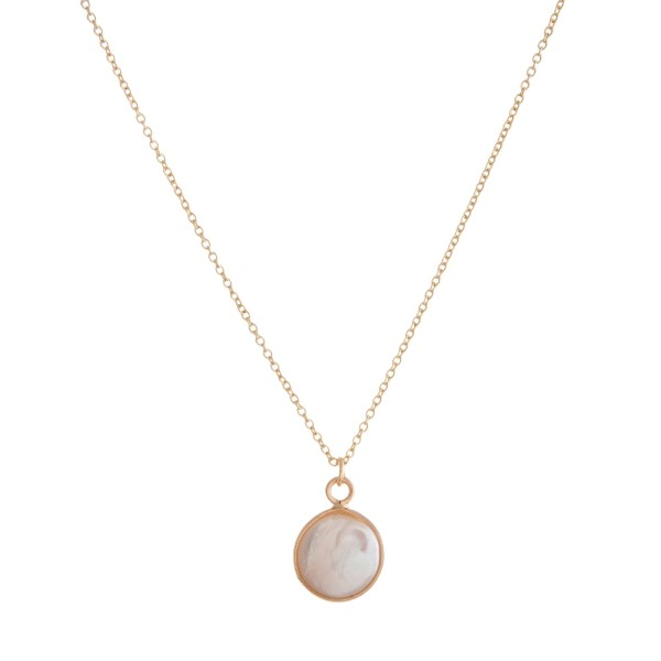 "Dainty gold tone necklace with a freshwater pearl bead pendant. Approximately 16"" in length."