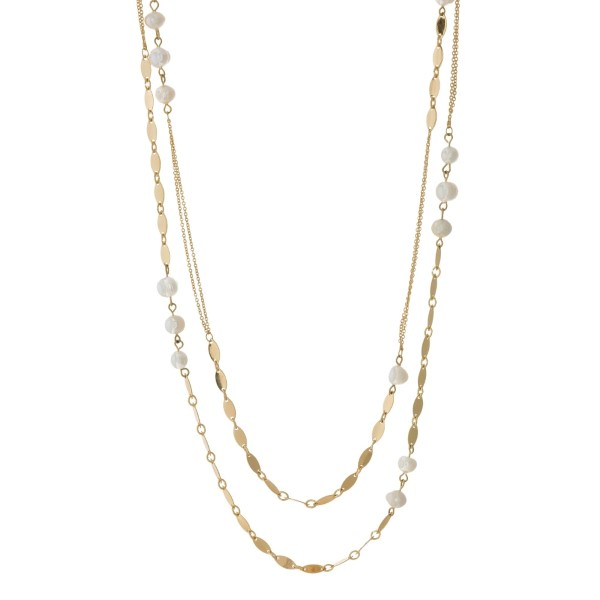 "Gold tone, two layer necklace with freshwater pearl bead accents. Approximately 34"" and 36"" in length."
