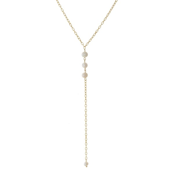 """Dainty gold tone Y necklace with freshwater pearl beads. Approximately 20"""" in length."""