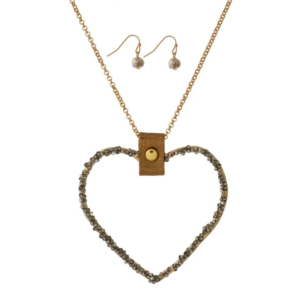 "Metal, necklace set with a heart shaped pendant and matching fishhook earrings. Approximately 32"" in length."