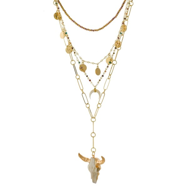 """Multi-layered, gold tone necklace with horn and skull pendants and beaded accents. Approximately 16"""" to 20"""" in length."""