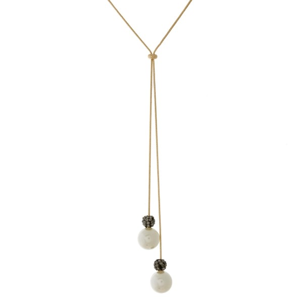 "Dainty, Y necklace with adjustable lariat and pearl beads. Adjustable up to 26"" in length."
