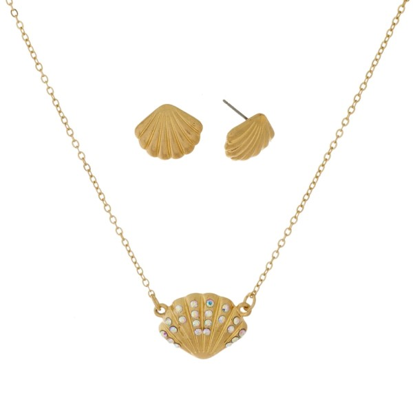 "Dainty necklace set with a seashell pendant and matching stud earrings. Approximately 16"" in length."
