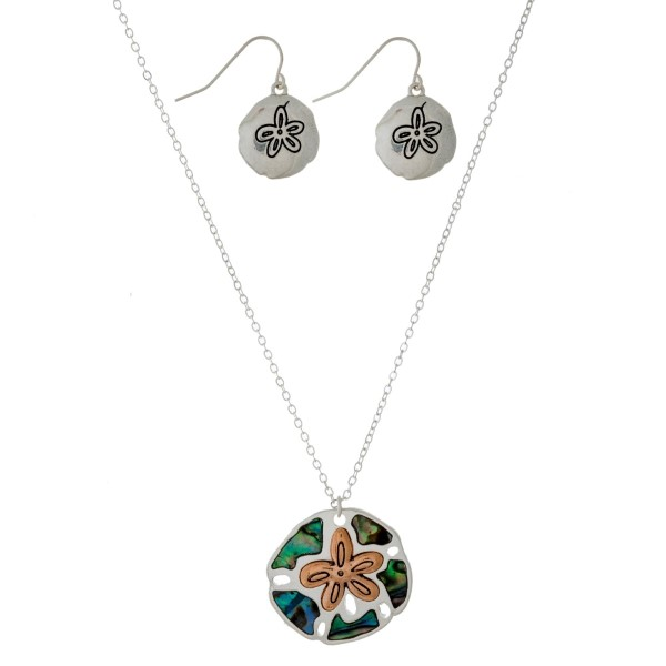 "Silver tone necklace set with a two-tone and abalone beach pendant. Approximately 16"" in length."