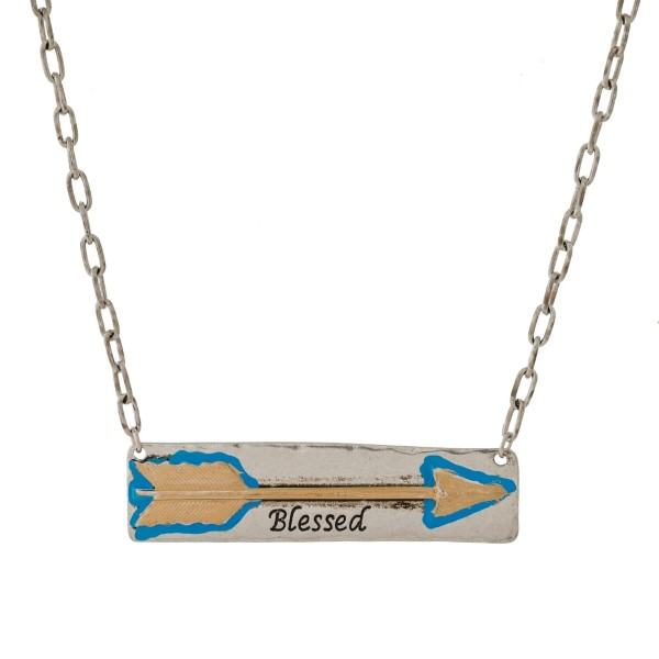 """Burnished metal necklace with a bar pendant, stamped with an arrow and """"Blessed."""" Approximately 16"""" in length."""