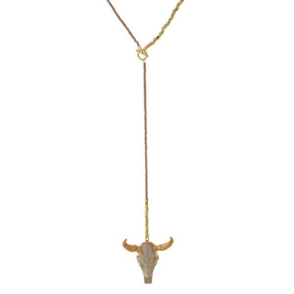 """Topaz and gold tone beaded Y necklace with a front toggle closure and a steer head pendant. Approximately 18"""" in length."""