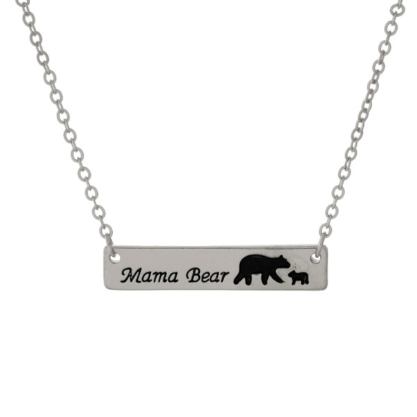 """Dainty, metal necklace with a bar pendant stamped with """"Mama Bear."""" Approximately 16"""" in length."""