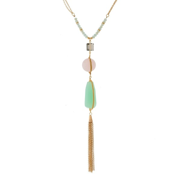 """Gold tone necklace with a beaded and natural stone pendant and chain tassel. Approximately 22"""" in length."""