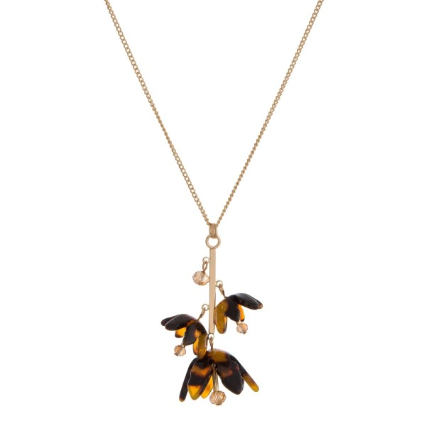 "Gold tone necklace with an acetate flower pendant. Approximately 30"" in length."