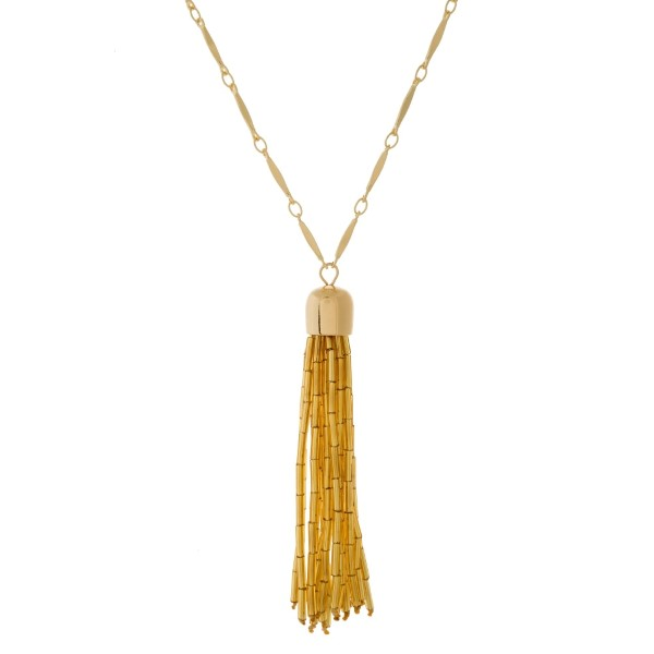 """Gold tone, link chain necklace with a metallic beaded tassel pendant. Approximately 30"""" in length."""
