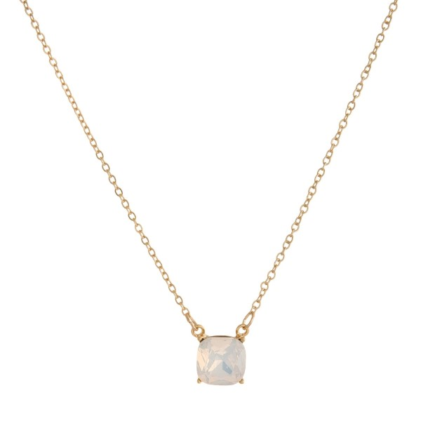 "Dainty gold tone necklace with a square rhinestone pendant. Approximately 16"" in length."