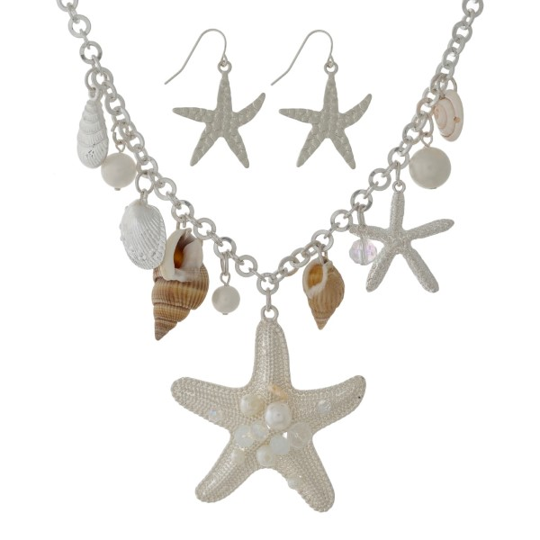 "Silver tone statement necklace set with shell, pearl bead and starfish pendants and matching fishhook earrings. Approximately 16"" in length."