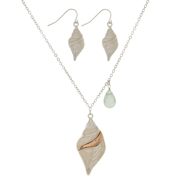 "Silver tone necklace set with an iridescent glittered beach pendant and matching fishhook earrings. Approximately 18"" in length."
