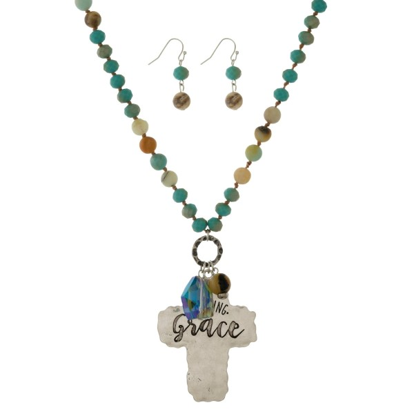 """Silver tone necklace with turquoise beads, amazonite beads and a stamped pendant. Approximately 30"""" in length."""